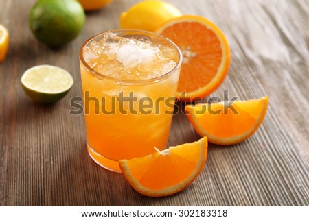 Glass of orange juice on wooden table, closeup