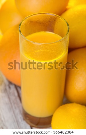 Glass of orange juice standing on the table