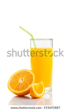 glass of orange juice with straw near half orange and slice on white background with space for text
