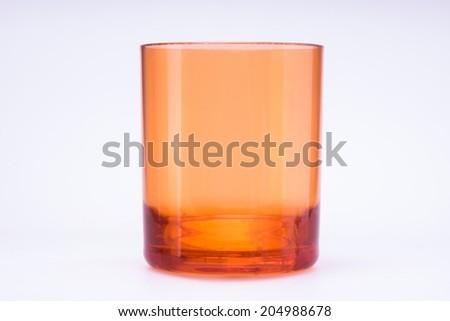 Glass of orange on white background. - stock photo