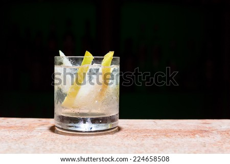 Glass of peach mojito on marble table - stock photo