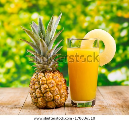 glass of pineapple juice with fresh fruits - stock photo