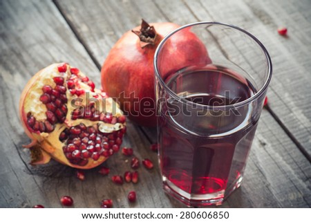 Glass of pomegranate juice with fresh fruits. Selective focus, shallow DOF - stock photo