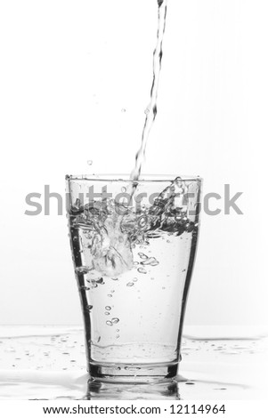 glass of pouring water with reflection (white background) - stock photo