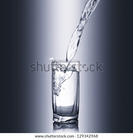 Glass of pure spring water - stock photo