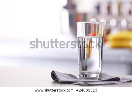 Glass of pure water on kitchen table