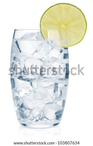 Glass of pure water with ice cubes and lime slice. Isolated on white background - stock photo