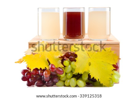 Glass of red stum and 2 glasses of white stum together with some green and red grapes photographed in the studio. - stock photo