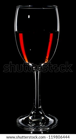 Glass of Red Wine against Black Background - stock photo