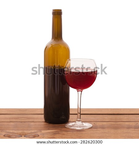 Glass of red wine and bottle on wooden background isolated. Flat mock up for design. - stock photo