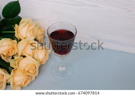 glass of red wine and flowers