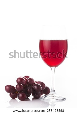 Glass of red wine and grape isolated on white - stock photo
