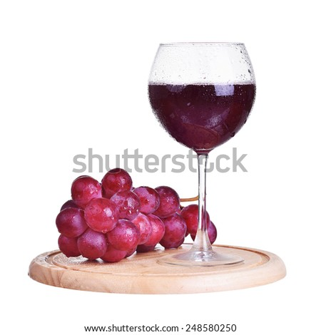 Glass of red wine and grapes, isolated on white - stock photo