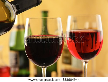 Glass of red wine and the bottle