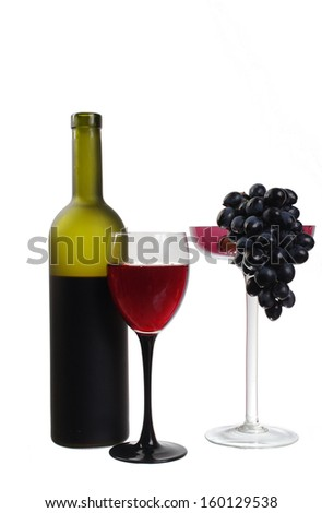 Glass of red wine, bottle, red rose and grapes. Isolated on white
