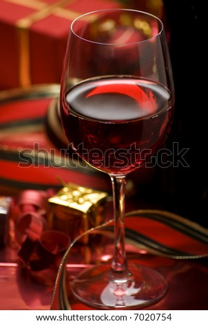 glass of red wine close up - christmas theme - stock photo