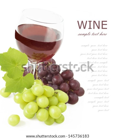 Glass of red wine,grapes and leaves isolated on white background with sample text