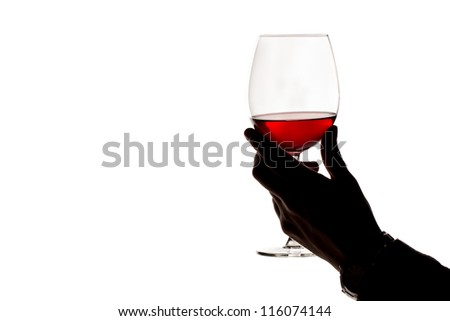 glass of red wine in hand, isolated - stock photo
