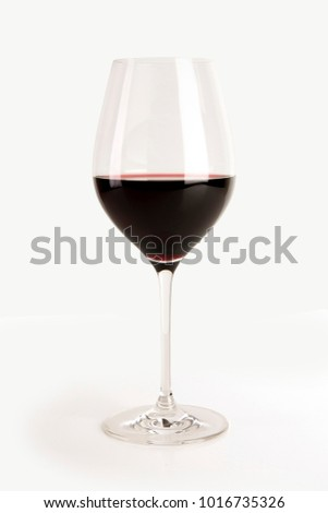 Glass of red wine isolated on white