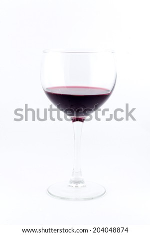 Glass of red wine isolated on white standing perfectly still