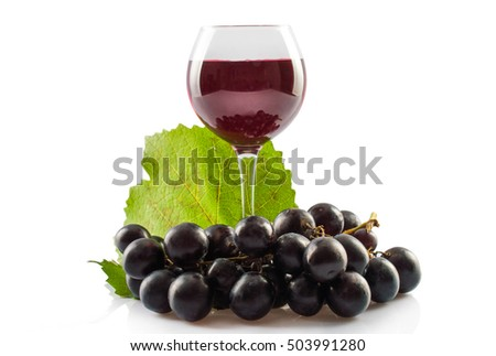 Glass of red wine. leaves of grapes a bunch of grapes. On white, isolated background.