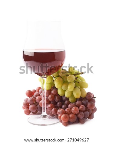 Glass of red wine next to the branches of white and dark red grapes isolated over the white background