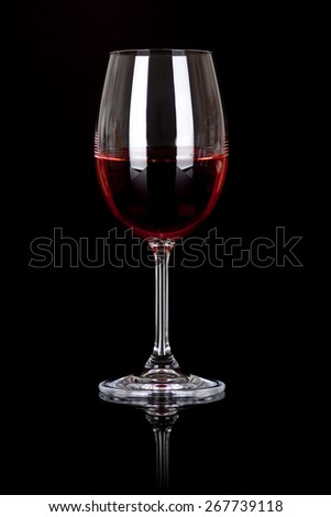 glass of red wine on black - stock photo