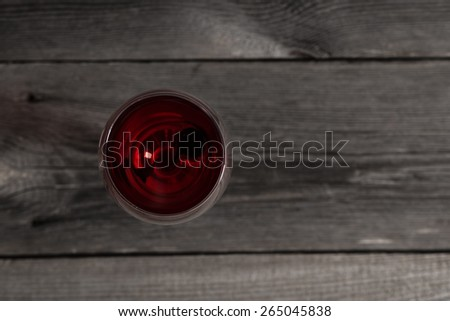 Glass of red wine on wooden table. View from top - stock photo