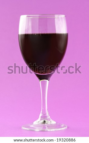 glass of red wine, pink background