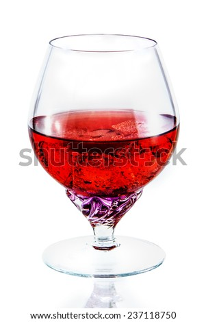 glass of red wine with ice - stock photo