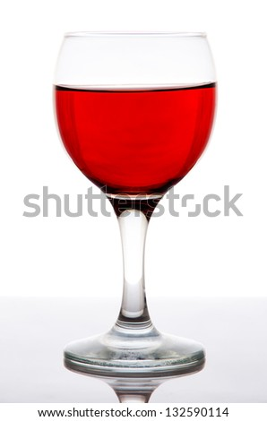 Glass of red wine with reflection, isolated on white background