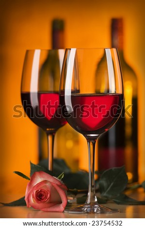 glass of red wine with rose close up shoot - stock photo