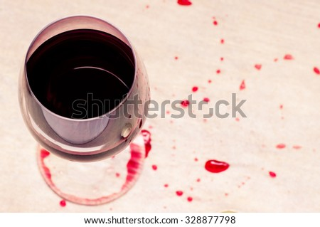 Glass of red wine with stains view from above