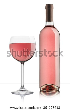 glass of rose wine with full bottle on white background