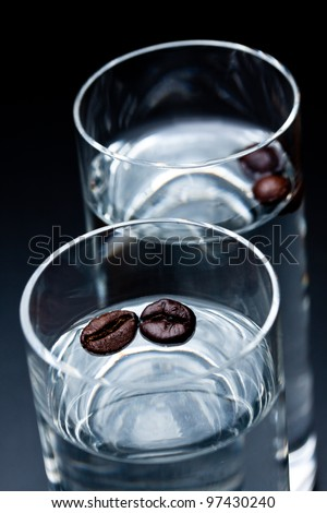 glass of sambuca with coffee beans - stock photo