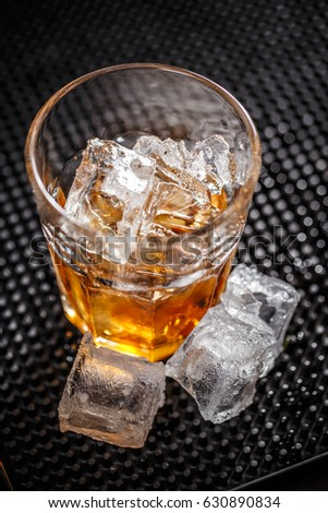 Glass of scotch whiskey with ice cubes