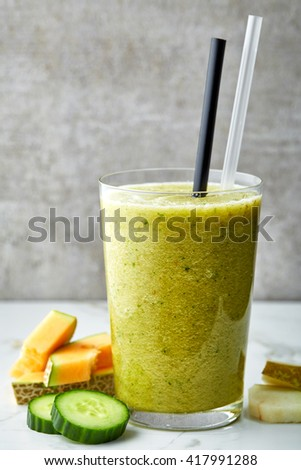 glass of smoothie on gray kitchen table