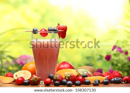 Glass of smoothie with fresh fruits - stock photo