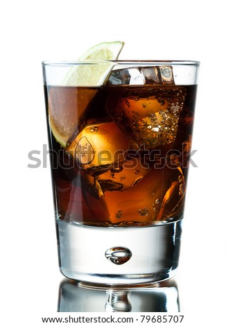 Glass of soda with ice cubes and lime, whiskey cola, cuba libre - stock photo