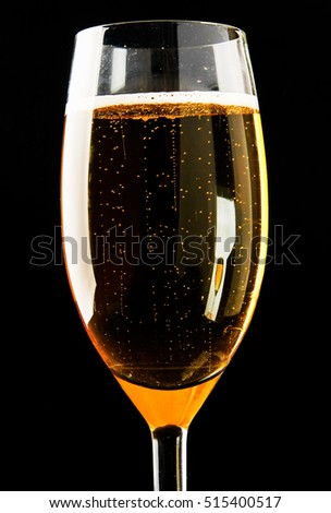 Glass of sparkling shampagne wine on a black background