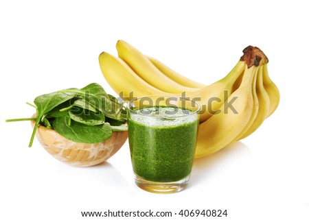 glass of spinach and banana smoothie over white background/ healthy food - stock photo