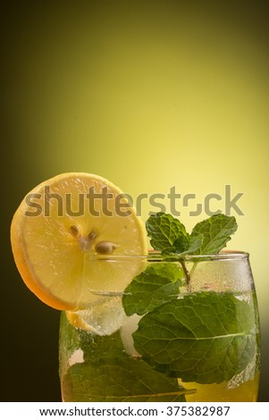 Glass of spritzer with lime and mint leaves