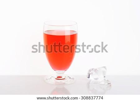 glass of strawberry juice on white background - stock photo