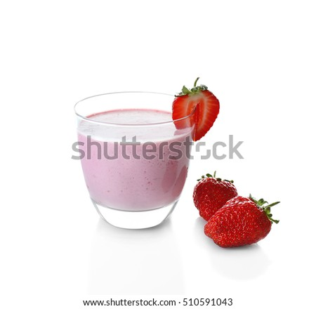 Glass of strawberry milk shake on white background