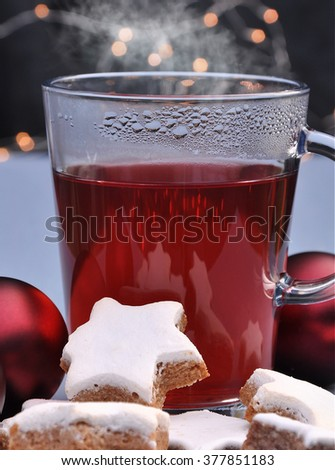 Glass of tea with cookies and Christmas ornaments