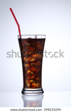 glass of the cola drink on the white background