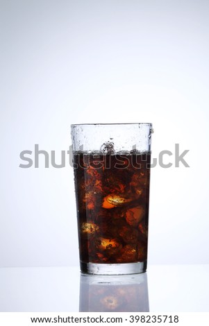 glass of the cola drink on the white background - stock photo