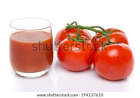 Glass of tomato juice with fresh tomatoes, isolated on white