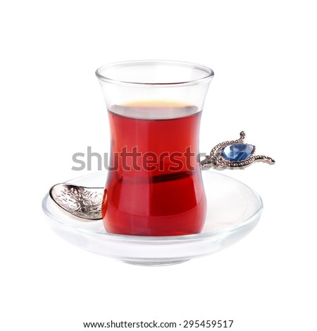 Glass of Turkish tea with spoon isolated on white background