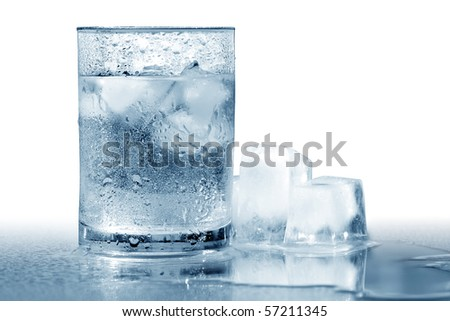 Glass of very cold water with ice cubes. Isolated with clipping path - stock photo